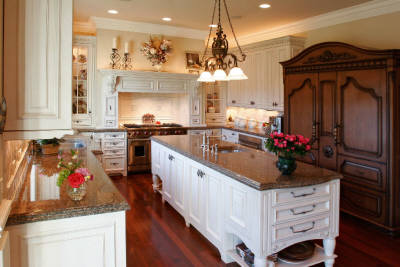 Remodeled kitchen with new granite countertops and custom cabinets